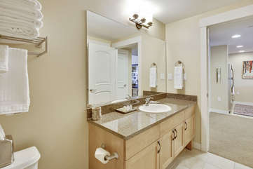 Fullsize guest bathroom with granite counter tops
