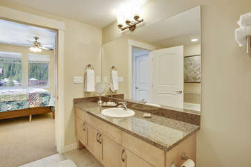 Master bathroom with large granite counter area