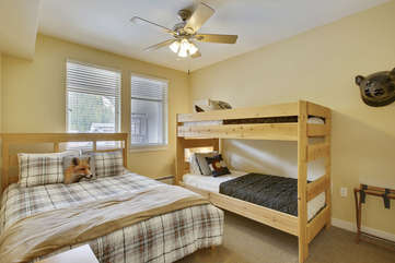 Bunk room with a full size bed and 2 twins