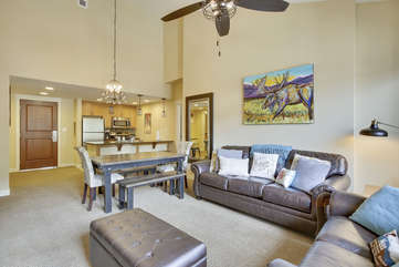 Large living and dining area with vaulted ceilings