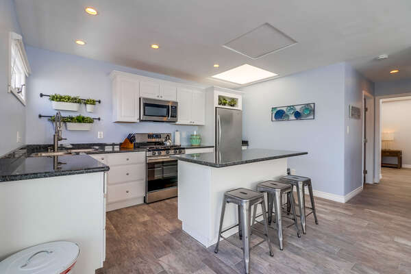 Modern kitchen with breakfast bar seating for 4.
