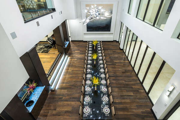 Indulge in an exquisite culinary experience in this spacious dining room with seating for up to 40