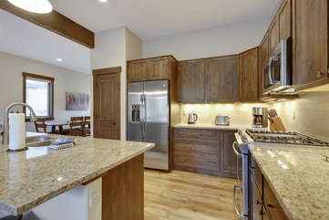 Large kitchen with custom slab granite counters