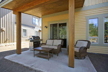 Rear patio with custom furniture and gas grill