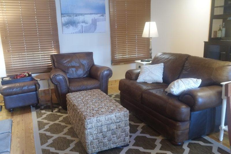 Family room area...check the wicker ottoman for kids toys!