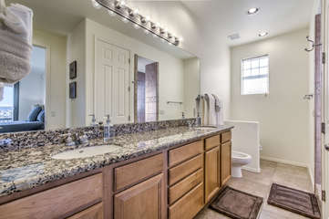 Master bath includes dual vanity sinks, walk-in shower and bidet