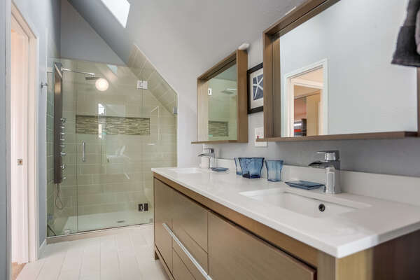 3rd floor bathroom with large shower, access from bedroom with King bed and hallway