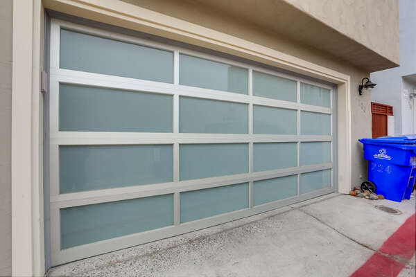 Garage is only big enough for 1 vehicle. Washer/Dryer is located garage as well as any beach gear. We do not take inventory of beach gear, you are more than welcome to use any gear in the home/garage.