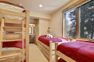 Lower level bunk room with 4 twin and 2 trundle beds