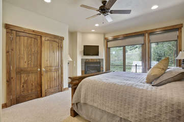 Master suite with gas fireplace, smart tv and amazing views from private deck