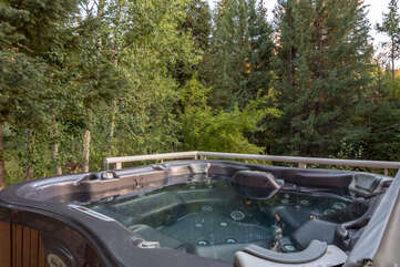 Soak in style surrounded by forest views