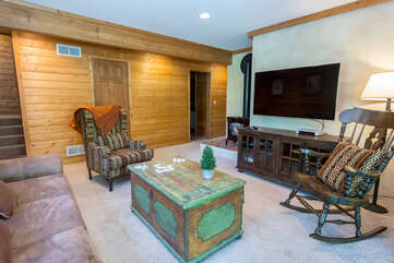 Lower level lounge with flat screen TV and gas fireplace