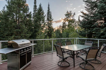 Main level deck with outdoor dining area and propane grill - the perfect place to watch the sun set