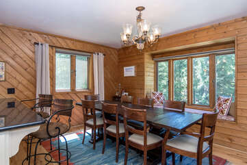Forest views surround the open dining area