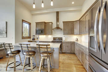 Open kitchen with custom counter bar