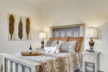 Master bedroom suite with a queen bed