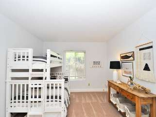 Downstairs bedroom - spacious and functional. Full bed with twin bunk and twin trundle