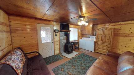 Lower level family room with  gas fireplace.washer and dryer for guests convenience.