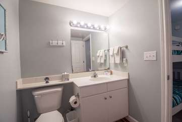 Guest full bathroom connected to bunk area