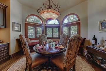The breakfast nook in the kitchen has bay windows that look out over the garden