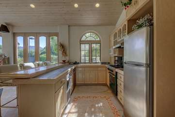 The casita kitchen has all the major appliances and settings with no reason to go to the main house