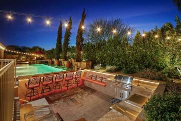 Sunken bar area has a large brand new barbecue, sink, fridge and rope lights under the ledge and around the perimeter