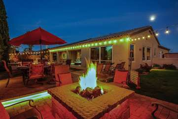 The stone fire pit is the perfect spot for a glass of wine under the stars