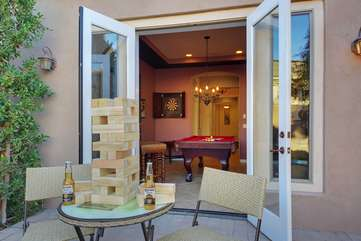 French doors provide a separate entrance to the game area