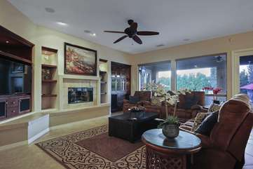 Enormous windows to easily see out to the pool area from the living room
