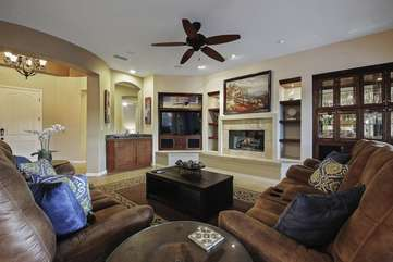 Open floor plan living room with multiple electric recliners lined up side by side