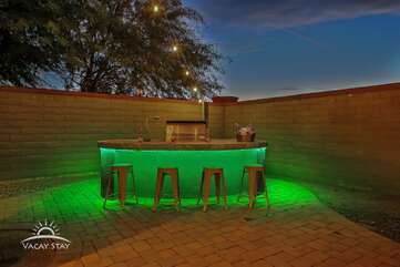 The Gas BBQ has colored LED lights and doubles as a bar with barstools
