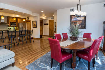 Open kitchen and dining areas with seating for six at the table