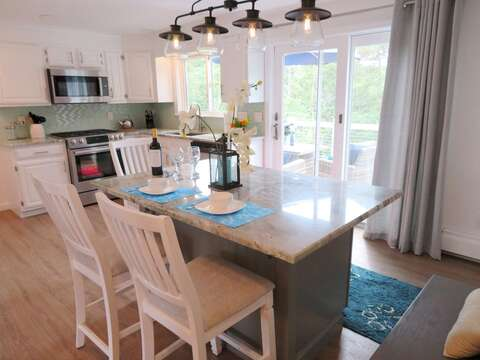 Island with 3 chairs and a small bench. Sliders to the deck - 162 Owl Pond Brewster Cape Cod - New England Vacation Rentals