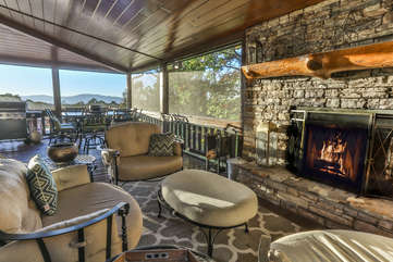 Enjoy a evening of dining on the deck by the outdoor woodburning fireplace.