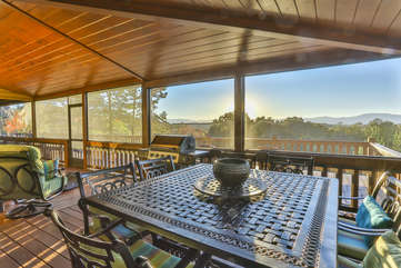 The screened porch as a dining table to seat eight.