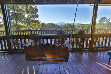 The porch swing is located on the screened porch and provides a awsome view of the mountains.