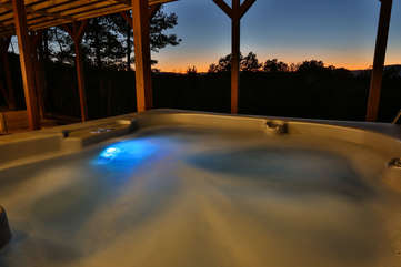 The hot tub is located off the family room on the lower level of the cabin.
