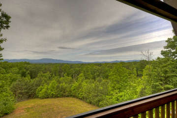 Enjoy the view of the beautiful Blue Ridge Mountains from the private third level screened porch off the master bedroom.