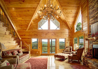 Enjoy spending family time in the Living Room Situated around the Gas Log Fireplace.  You can also enjoy the long range mountain view from the windows and the covered front porch.