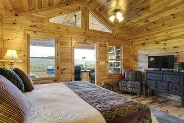 The Master Bedroom is located on the Upper Level of this tastefully decorated home. This bedroom offers you a spectacular reading area with a wall of windows that provides long range mountain views for you to wake up to everyday. King Bed with a Flat Screen TV