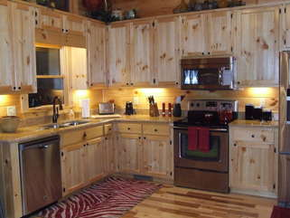 Enjoy the fully furnished kitchen with Stainless Steel Appliances. Adjoining dining area has a table with seating for 6 guests.