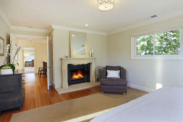 Retreat into the quiet main bedroom suite with private sitting area and fireplace