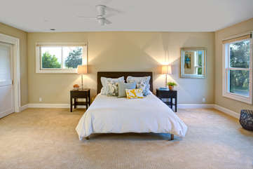 Settle in for a restful stay, buried in luxurious linens in the main bedroom