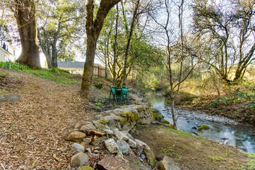 A storybook stream meanders through the property