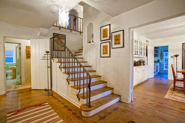 Original oak floors, wide doorways, handcrafted railing — timeless beauty