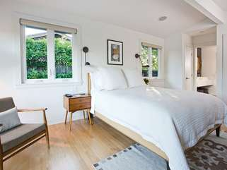 Comfortable amenities and an en suite bath invite you to make yourself at home in the main bedroom
