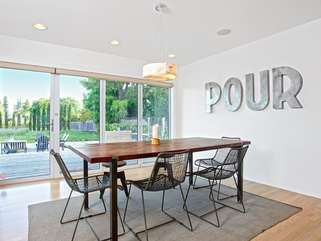 Whether you're sharing dinner or a game of cards, the open dining area inspires good times