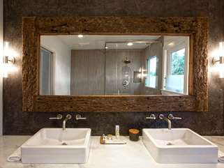 Take advantage of the spa-like main bath — marble, tile, wood, and double sinks