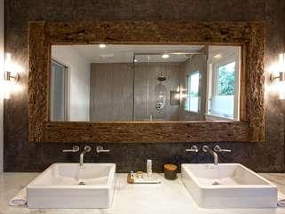 Take advantage of the spa-like main bath — marble, tile, wood, and double sinks
