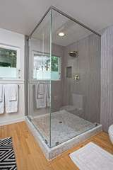 Rinse away the demands of everyday life in the main bath's beautiful and spacious tiled shower
